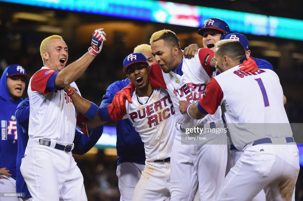 Eddie Rosario #17 of the Puerto Rico celebrates with teammates after getting the game-winning hit in the 11th inning for a 4-3 win over team Netherlands during Game 1 of the Championship Round of the 2017 World Baseball Classic at Dodger Stadium on March 20, 2017 in Los Angeles, California. Puerto Rico won 4-3 in the 11th inning.