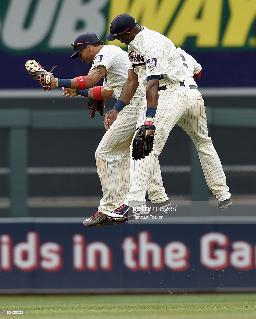 Eddie Rosario #20, Torii Hunter #48 and Aaron Hicks #32 of the Minnesota Twins celebrate a win of the game against the Detroit Tigers on July 11, 2015 at Target Field in Minneapolis, Minnesota. The Twins defeated the Tigers 9-5.