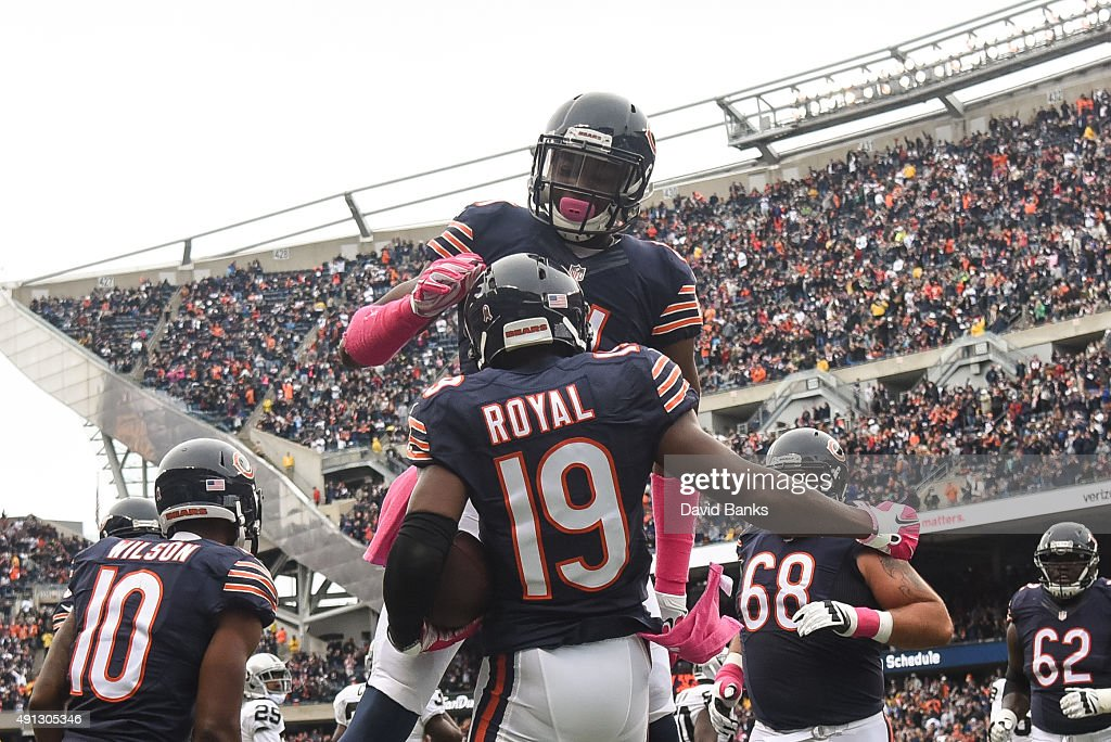 Eddie Royal #19 of the Chicago Bears celebrates with Cameron Meredith #81 after scoring against the Oakland Raiders in the first quarter at Soldier Field on October 4, 2015 in Chicago, Illinois.