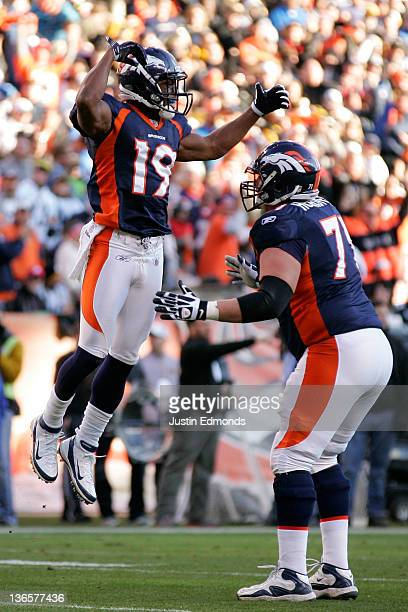 Eddie Royal of the Denver Broncos celebrates with his teammate Russ Hochstein after catching a touchdown pass in the second quarter against the...