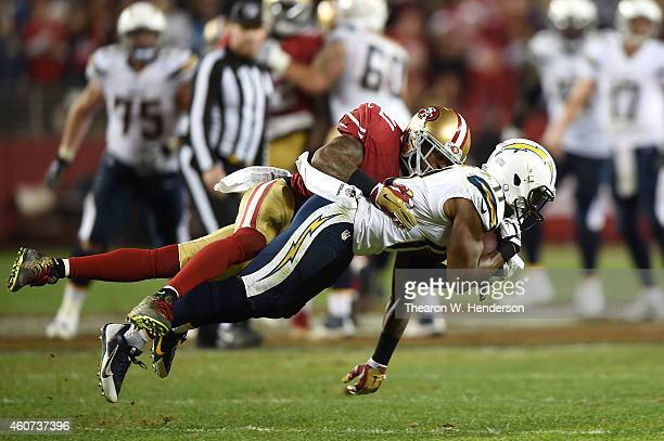 Eddie Royal of the San Diego Chargers completes a 17 yard pass against the tackle of Antoine Bethea of the San Francisco 49ers in the fourth quarter...