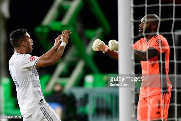 Eddie Segura congratulates teammate Kenneth Vermeer of Los Angeles FC after he stopped a penalty kick shot by Nani of Orlando City during a quarter...