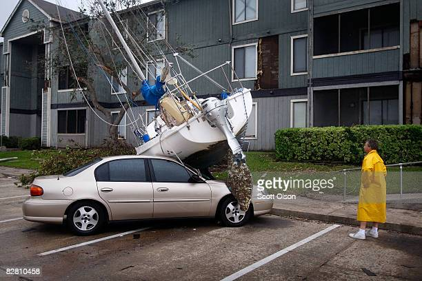 Eddie Settlocker checks damage caused by Hurricane Ike at an apartment complex he manages September 14 2008 in Galveston Texas Ike made landfall...