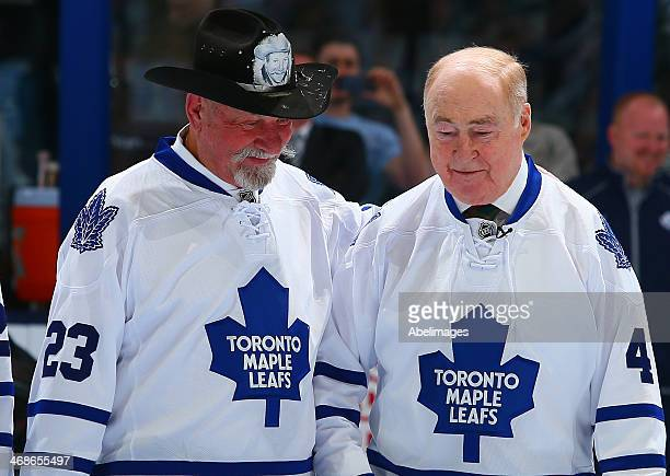 Eddie Shack and Red Kelly talk during a ceremony commemorating the 50th anniversary of the Leafs 64' Stancley Cup before action between the Toronto...