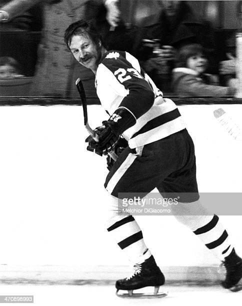 Eddie Shack of the Toronto Maple Leafs skates on the ice during an NHL game circa 1975 at the Maple Leaf Gardens in Toronto Ontario Canada