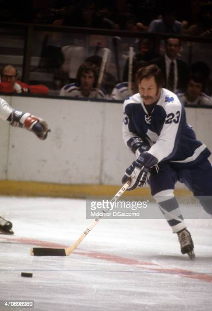 Eddie Shack of the Toronto Maple Leafs skates with the puck during an NHL game against the New York Rangers circa 1974 at the Madison Square Garden...