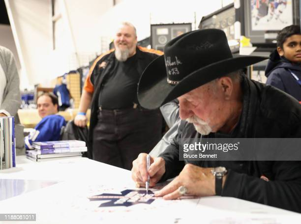 Eddie Shack signs autographs during the Sports Memorabilia Show on November 16 2019 at the International Centre in Mississauga Ontario Canada