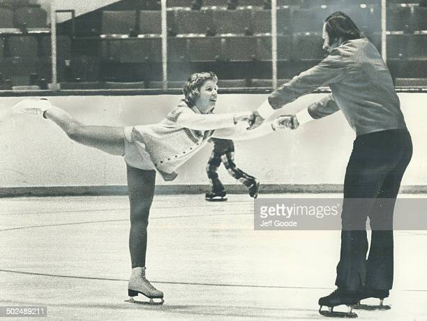 Eddie Shack the Maple Leafs' flamboyant winger is stationary for this instant as he guides 13yearold Cindy Bower daughter of former Leaf goalie in an...