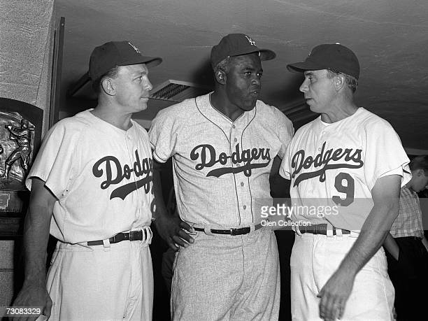 Eddie Stanky Jackie Robinson and Pee Wee Reese former Brooklyn Dodgers meet in the lockerroom prior to Old Timer's Day on July 25 1964 at Shea...