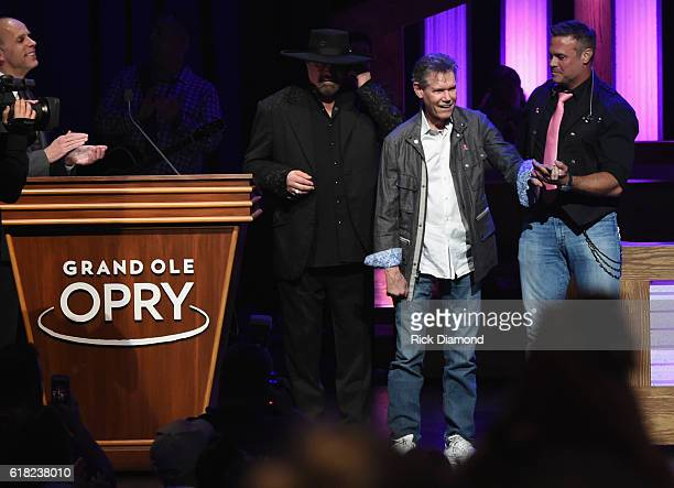 Eddie Stubbs introduces Eddie Montgomery and Troy Gentry who escort Singer/Songwriter Randy Travis on stage at Jason Aldean's 11th Annual Event...