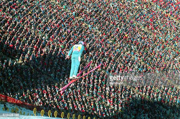 Eddie The Eagle Edwards soars over the crowd as he makes his second jump of the day during the 90 meter ski jump competition today Edwards Britain's...