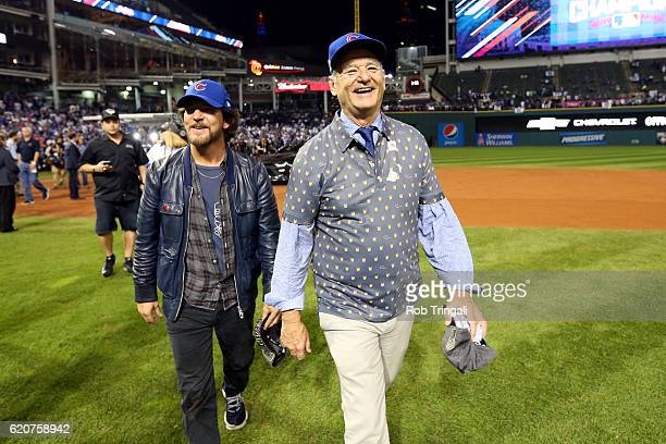 Eddie Vedder and Bill Murray celebrate on the field after the Chicago Cubs defeated the Cleveland Indians in Game 7 of the 2016 World Series at...