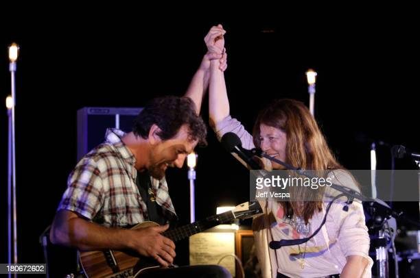 Eddie Vedder and Catherine Keener peform onstage during Eddie Vedder and Zach Galifianakis Rock Malibu Fundraiser for EBMRF and Heal EB on September...