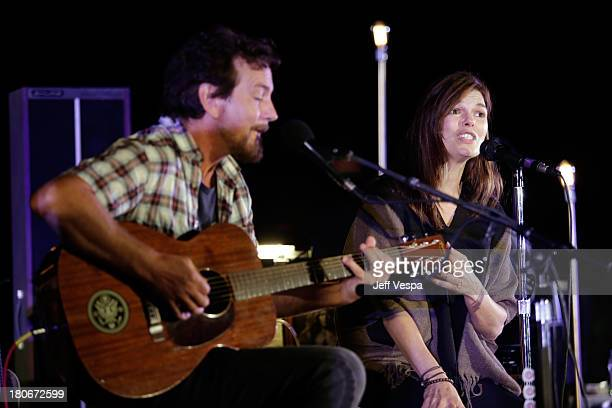 Eddie Vedder and Jeanne Tripplehorn peform onstage during Eddie Vedder and Zach Galifianakis Rock Malibu Fundraiser for EBMRF and Heal EB on...