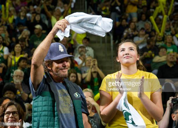 Eddie Vedder of Pearl Jam and his daughter Olivia cheer on the Seattle Storm during the second half of Game 2 of the WNBA Finals at KeyArena on...