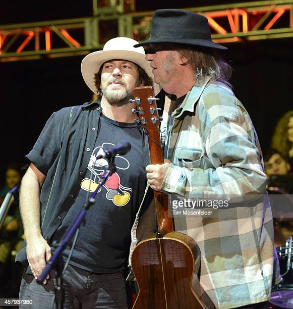Eddie Vedder of Pearl Jam and Neil Young perform during the 28th annual Bridge School Benefit at Shoreline Amphitheatre on October 26 2014 in...