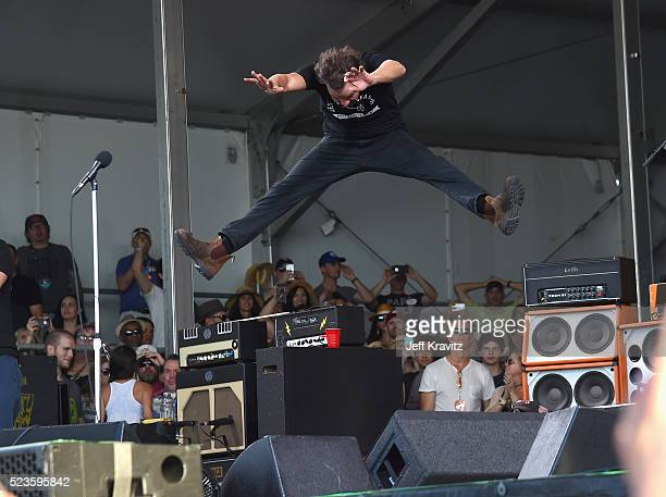 Eddie Vedder of Pearl Jam leaps onstage at the 2016 New Orleans Jazz Heritage Festival at Fair Grounds Race Course on April 23 2016 in New Orleans...