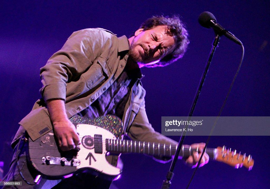 Eddie Vedder of Pearl Jam performs at the LA Sports Arena on Nov. 23, 2013.  Pearl Jam performs at : News Photo
