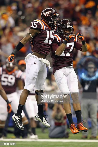 Eddie Whitley and Kyle Fuller of the Virginia Tech Hokies celebrate after Fuller intercepted a pass in the first half against the Michigan Wolverines...