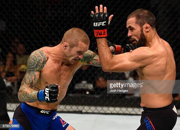 Eddie Wineland punches Frankie Saenz in their bantamweight bout during the UFC Fight Night event at the United Center on July 23 2016 in Chicago...