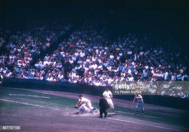 Eddie Yost of the Detroit Tigers is late to tag out Vic Power of the Cleveland Indians during an MLB game on July 5 1959 at Briggs Stadium in Detroit...
