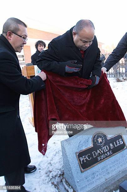 Eddie YuenPui Lee left and Mayor Daniel Rivera unveiled a plaque honoring PFC David B Lee during a rededication ceremony in Lawrence Mass on January...