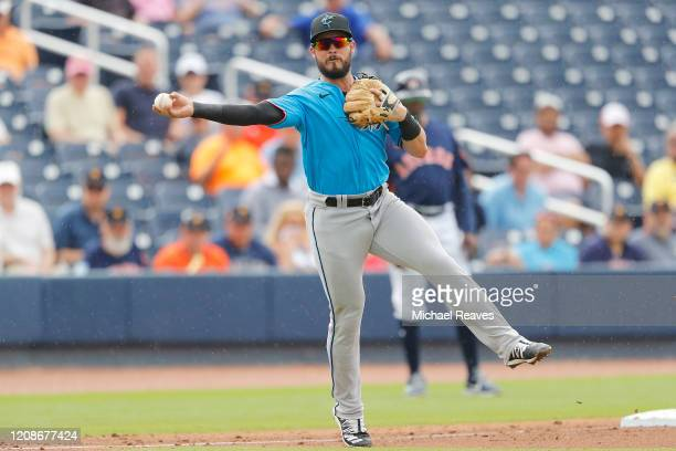 Eddy Alvarez of Miami Marlins throws out a runner against the Houston Astros in the fifth inning of a Grapefruit League spring training game at...