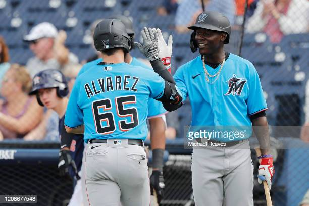 Eddy Alvarez of the Miami Marlins celebrates with Jazz Chisholm after hitting a solo home run against the Houston Astros in the seventh inning of a...