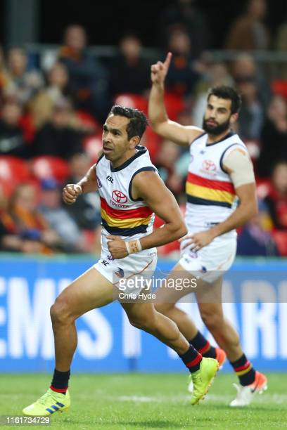 Eddy Betts of the Crows celebrates a goal during the round 17 AFL match between the Gold Coast Suns and the Adelaide Crows at Metricon Stadium on...