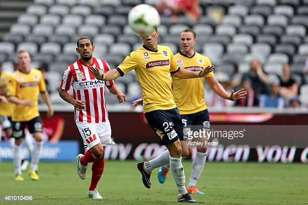 Eddy Bosnar and Zachary Anderson of the Mariners watch the ball with David Williams of Melbourne City in frame during the round 15 ALeague match...