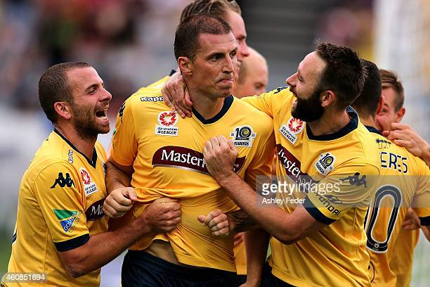 Eddy Bosnar of the Mariners celebrates a goal with team mates Storm Roux and Glen Trifiro during the round 13 A-League match between the Central...