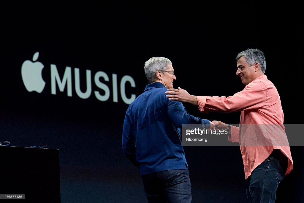 Eddy Cue, senior vice president of Internet Software and Services at Apple Inc., right greets Tim Cook, chief executive officer of Apple Inc., on stage during the Apple World Wide Developers Conference (WWDC) in San Francisco, California, U.S., on Monday, June 8, 2015. Apple Inc. kicked off its annual developers conference in San Francisco, where the company will unveil a revamped streaming-music service, improvements to its mobile software and tools to speed up smartwatch applications. Photographer: David Paul Morris/Bloomberg via Getty Images