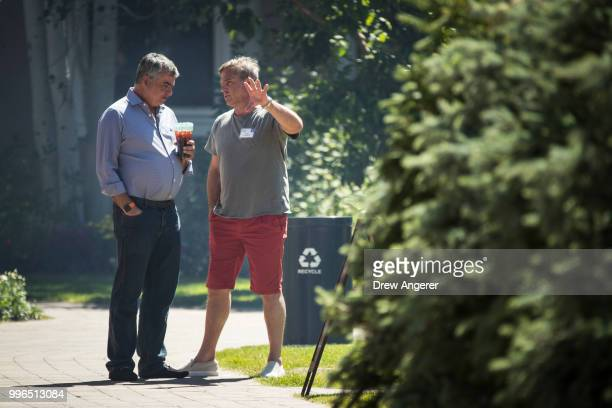 Eddy Cue senior vice president of Internet Software and Services at Apple talks with Owen Van Natta former chief operating officer at Facebook during...