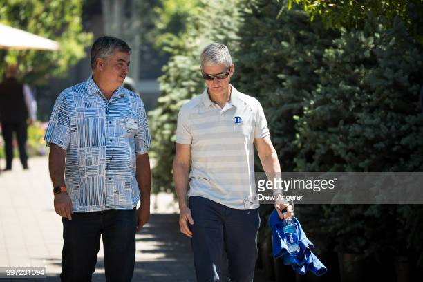 Eddy Cue senior vice president of Internet Software and Services at Apple and Tim Cook chief executive officer of Apple attend the annual Allen...