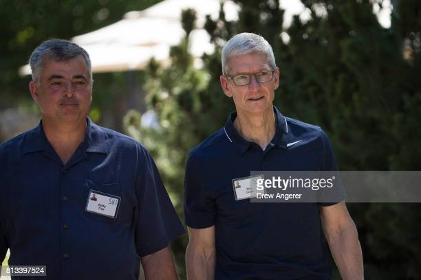 Eddy Cue senior vice president of internet software and services for Apple and Tim Cook chief executive officer of Apple walk with each other on the...
