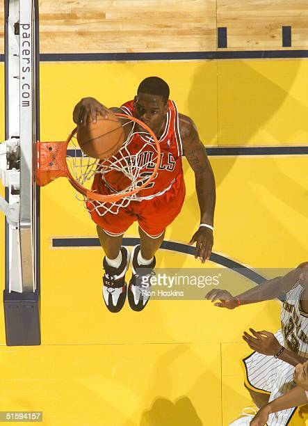 Eddy Curry of the Chicago Bulls jams against the Indiana Pacers during the preseason at Conseco Fieldhouse on October 27, 2004 in Indianapolis,...