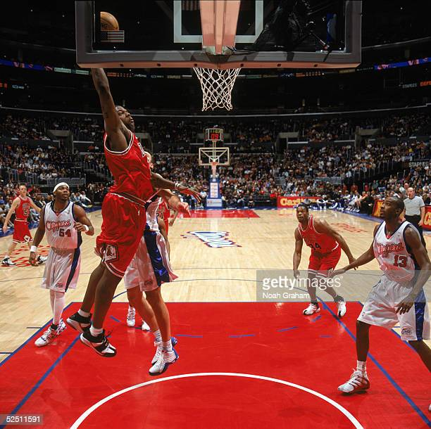 Eddy Curry of the Chicago Bulls makes a dunk against the Los Angeles Clippers at Staples Center on March 13 2004 in Los Angeles California The...