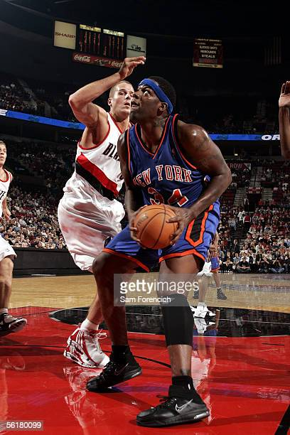 Eddy Curry of the New York Knicks looks to shoot over Joel Przybilla of the Portland Trail Blazers on November 9 2005 at the Rose Garden Arena in...