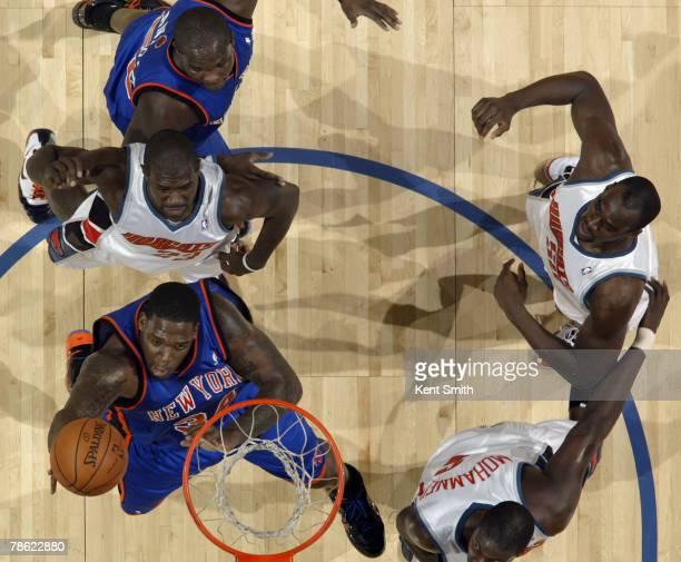 Eddy Curry of the New York Knicks shoots against the Charlotte Bobcats at the Charlotte Bobcats Arena December 21 2007 in Charlotte North Carolina...