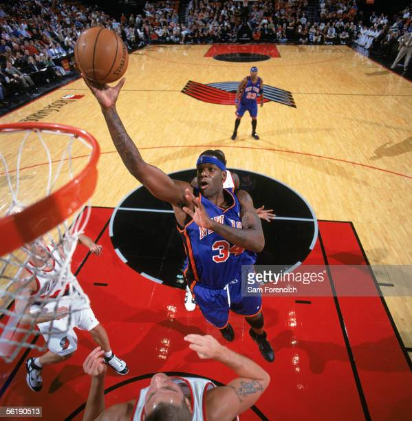Eddy Curry of the New York Knicks shoots over Joel Przybilla of the Portland Trail Blazers during a game at The Rose Garden on November 9 2005 in...