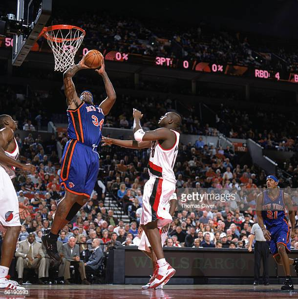 Eddy Curry of the New York Knicks takes the ball to the basket past Zach Randolph of the Portland Trail Blazers during a game at The Rose Garden on...