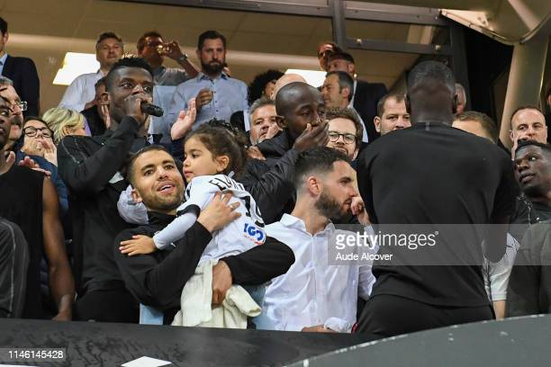Eddy Gnahore and Prince Gouano of Amiens crying during the Ligue 1 match between Amiens Sporting Club and EA Guingamp on May 24 2019 in Amiens France
