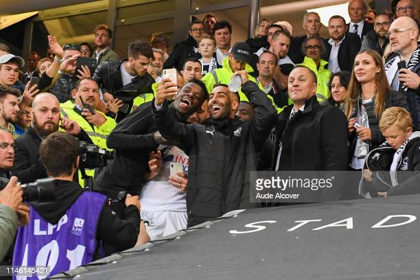 Eddy Gnahore and Salam Ghoddos of Amiens celebrate victory during the Ligue 1 match between Amiens Sporting Club and EA Guingamp on May 24 2019 in...