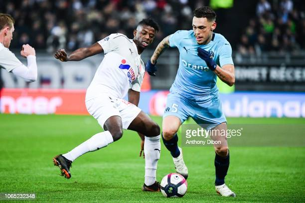 Eddy Gnahore of Amiens and Lucas Ocampos of Marseille during the Ligue 1 match between Amiens and Marseille at Stade de la Licorne on November 25...