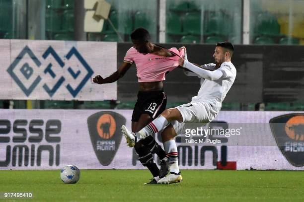 Eddy Gnahore' of Palermo is challenged by Leandro Greco of Foggia during the Serie B match between US Citta di Palermo and Foggia on February 12 2018...