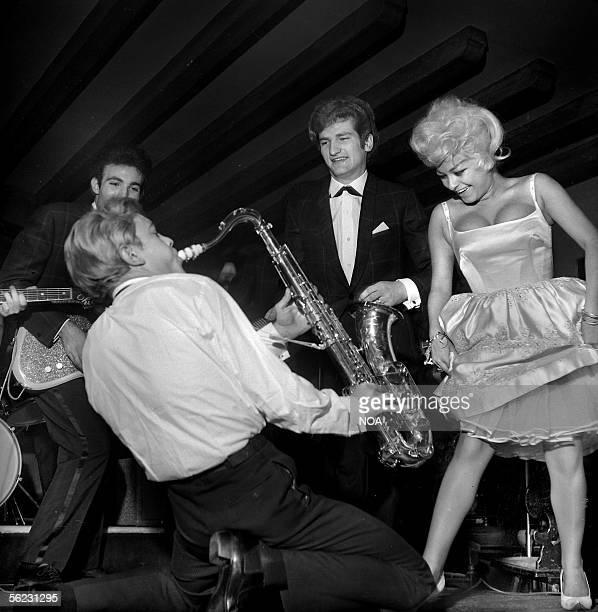 """Eddy Mitchell singing with """"Les Chaussettes noires """". Paris, Club Saint-Hilaire, 1963-65. HA-1233-8."""
