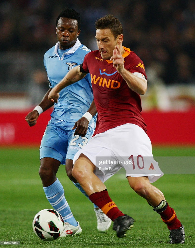 Eddy Onazi (L) of S.S. Lazio competes for the ball with Francesco Totti of AS Roma during the Serie A match between AS Roma and S.S. Lazio at Stadio Olimpico on April 8, 2013 in Rome, Italy.