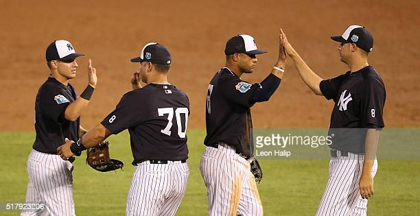 Eddy Rodriguez of the New York Yankees celebrates a win over the Detroit Tigers during a Spring Training Game on March 28 2016 at George M...