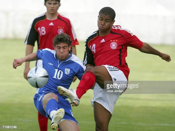 Ede Chinedu of Germany vies for the ball with Efrem Georgios during the UEFA Under 19 qualification round between Germany and Cyprus at the Estadio...
