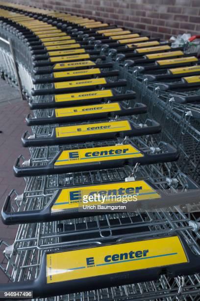 Edeka supermarket advertising poster and shopping carts
